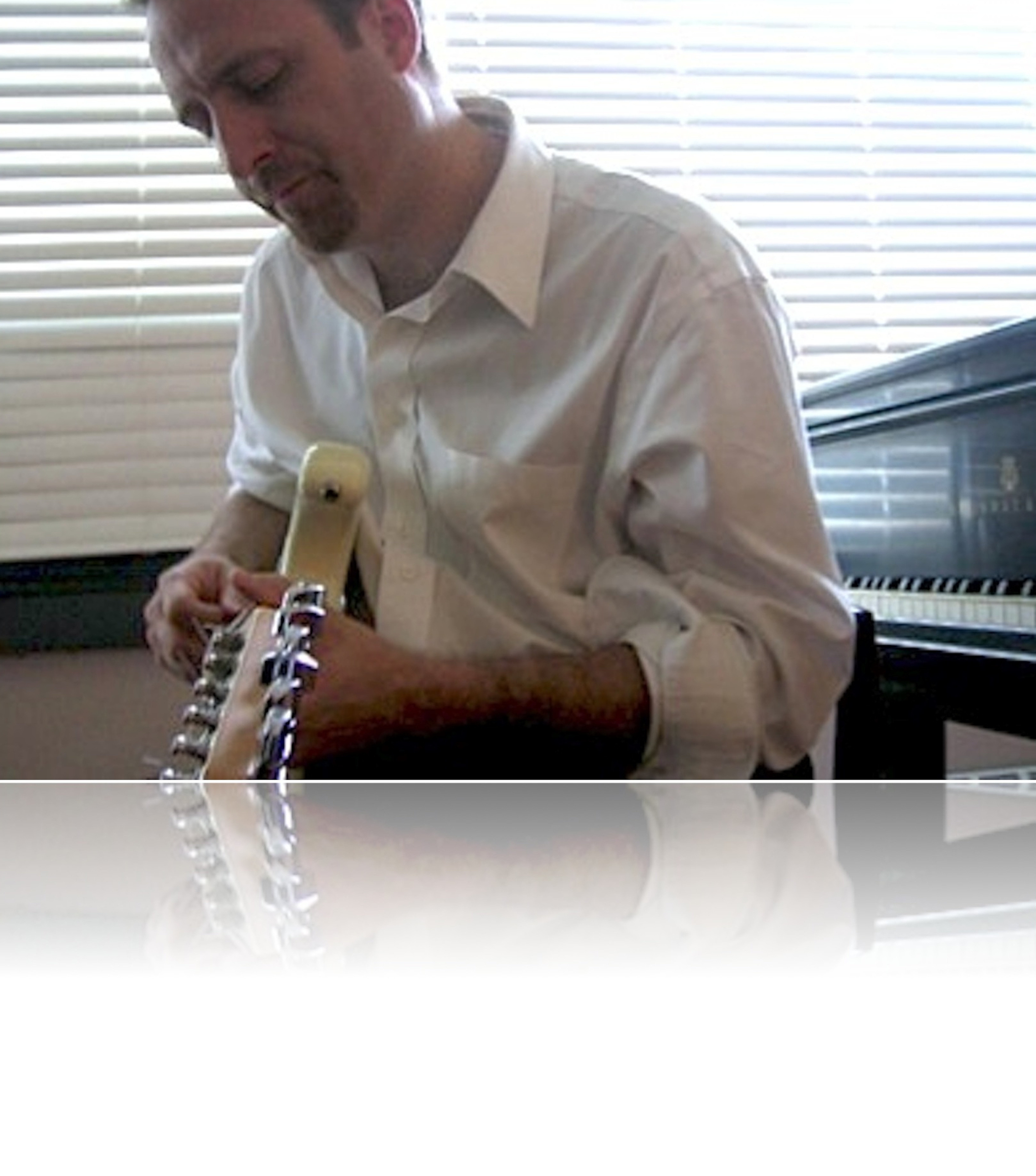 Jim+playing+guitar+at+piano_reflection