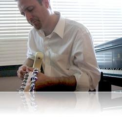 Jim+playing+guitar+at+piano_reflection