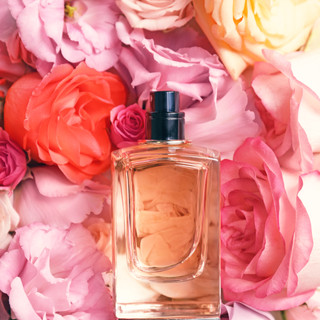 Top view of bottle with perfume on beaut
