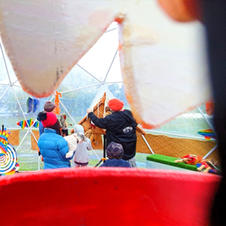 A lovely family ducked into our igloo to play with the Maui brother puppets.