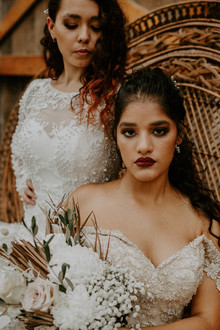 Photography: Camilla French Photography Olivia Walker  Medha Chaturvedi Hair-  Beloved Bohemian Makeup-  Allie Grigg Creative Location- NQ Elite Rodeo Townsville. Florals - Blooms by Bevilacqua Gowns - Wedding Gowns by Melinda Decorations - Dreamscene Events & Vintage Styling Co