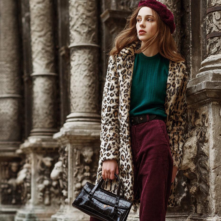 Outdoor fashion portrait of woman wearin