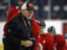 Calgary Flames head coach Bill Peters gives instruction during training camp in Calgary, Friday, Sept. 13, 2019. THE CANADIAN PRESS/Jeff McIntosh Peters.jpg