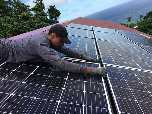 Volunteer Hard at Work on a Solar Panel.
