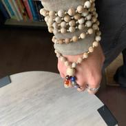 Sandalwood Chakra Mala on wrist.jpg