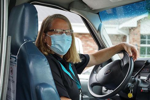Woman driving transportation van