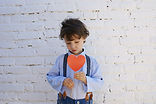photo-of-boy-holding-heart-shape-paper-o