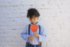 photo-of-boy-holding-heart-shape-paper-o