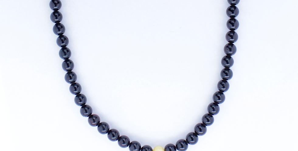 Halskæde med dybrødt rav. små beads