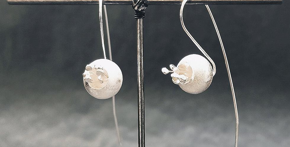Øreringe med glitterblomst