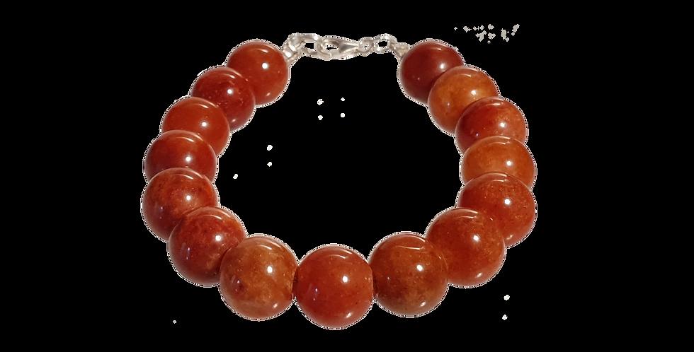 Armbånd med jade i brændt orange farve