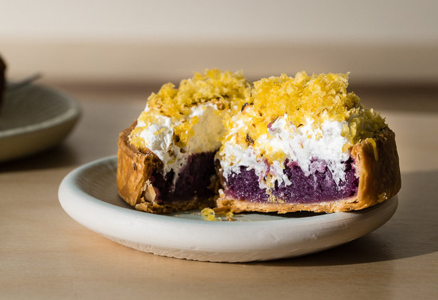 A cross section of the Not Ube! tart reveals a rich and sticky blend of purple sweet potatoes crowned with toasted meringue and salted egg yolk shavings. (Sarah Chorey)