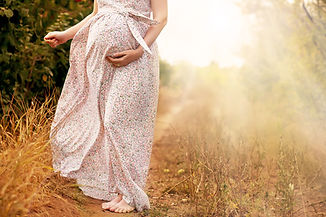 Pregnant woman in nature
