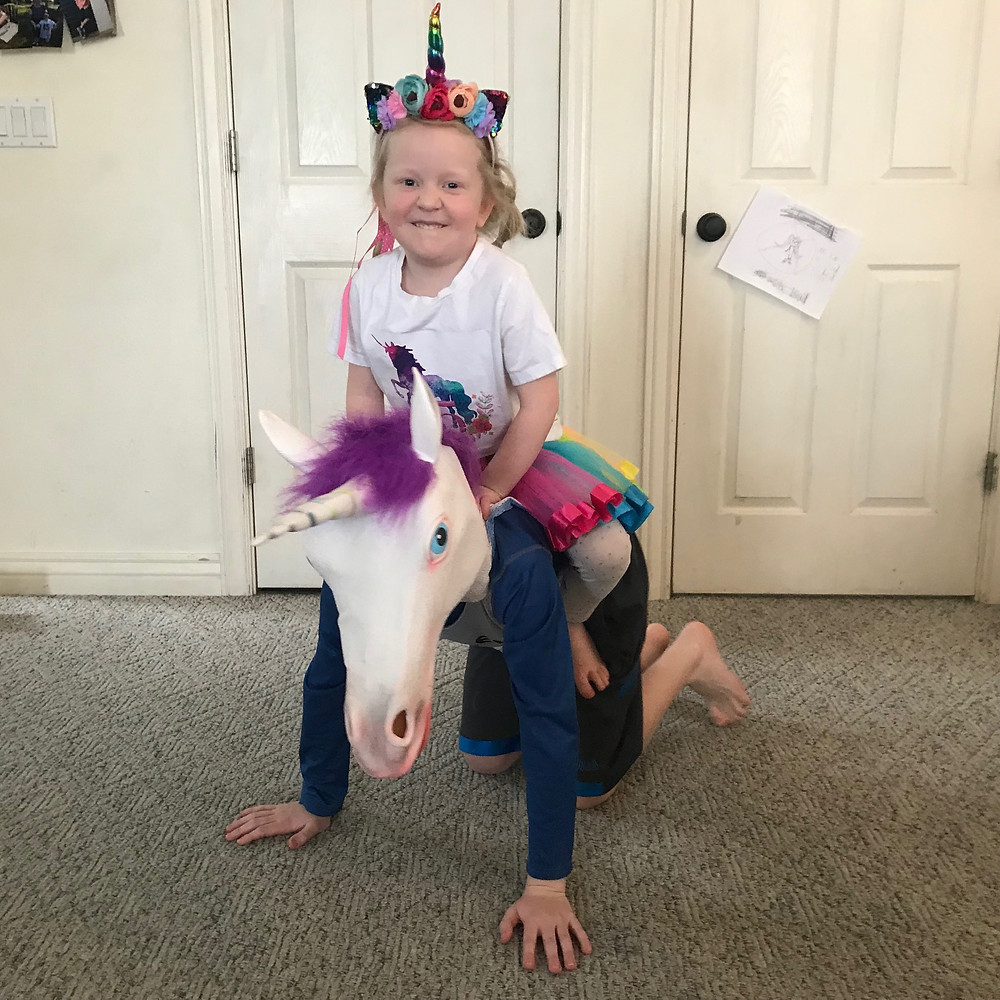 Riding her unicorn