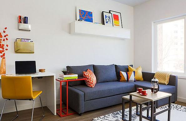 A furnished living room it modern furniture