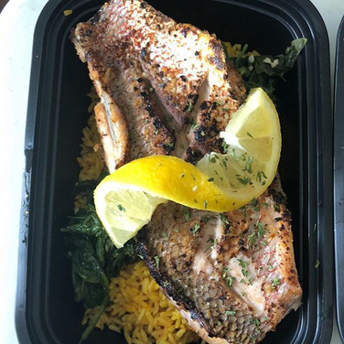 Red snapper, yellow rice, and spinach...