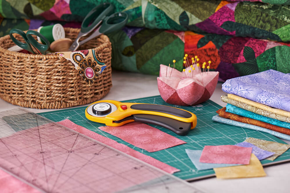 quilting materials on a table - quilting vs embroidery