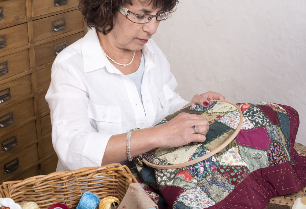 woman doing an embroidery - quilting hoop vs embroidery hoop