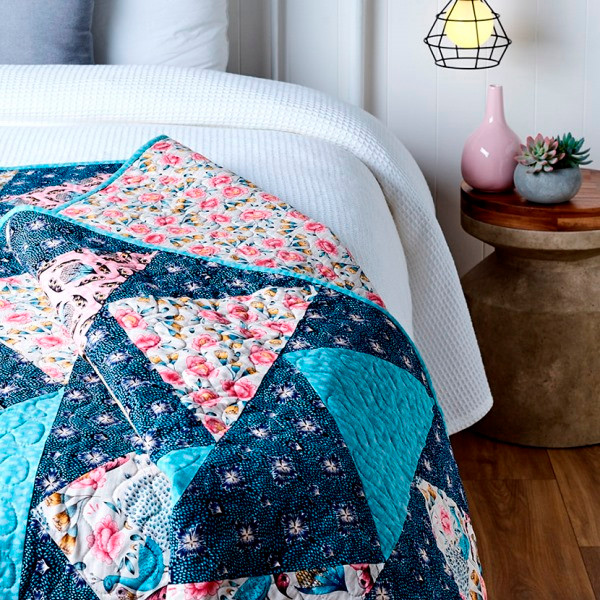 Quilt on top of a bed - quilt patterns for beginners