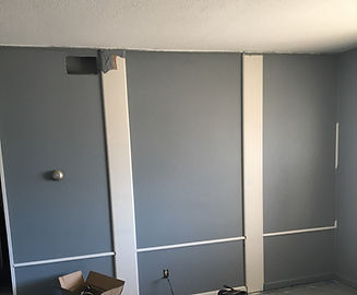 Blue wall with white paneling