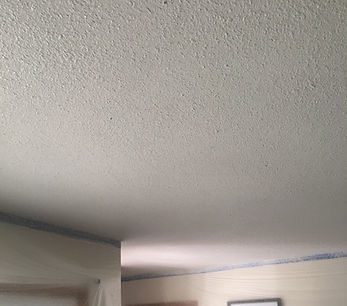 Popcorn ceiling with white paint