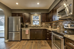 craftsman-kitchen-with-breakfast-bar-glass-wall-and-laminate-flooring-i_g-ISx7w9e9uujunu1000000000-O