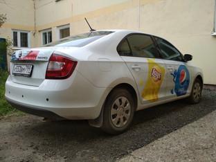 Брендирование автомобилей.  Аппликация цветными пленками ORACAL и фотопечать  с УФ-ламинацией.