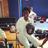 Kenyatta in fencing gear.