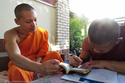 A Monk Signs the Book