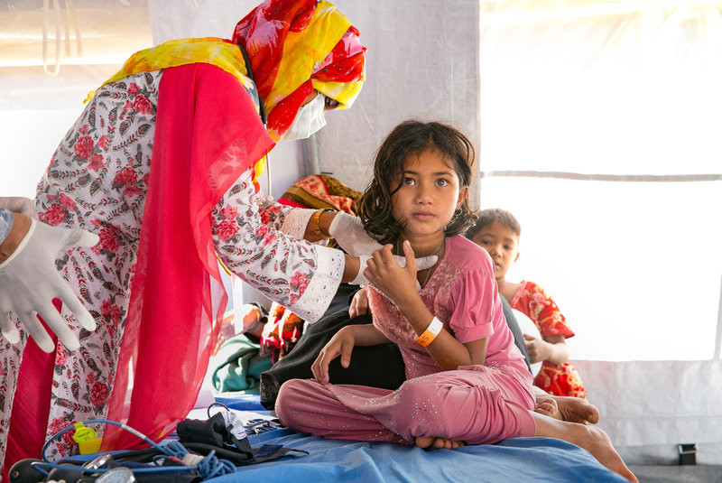 Patients are treated at the Samaritan's Purse diphtheria clinic in the Balukhali Rohingya refugee camp in Chittagong district, Bangladesh. Allison Joyce for NPR
