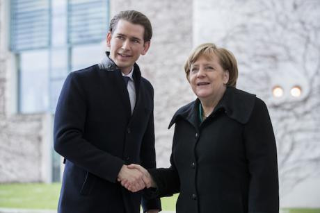 German Chancellor Angela Merkel greets Austrian Chancellor Sebastian Kurtz upon his arrival at the Chancellery in Berlin, Germany on January 17, 2018. NurPhoto/Press Associations. All rights reserved.