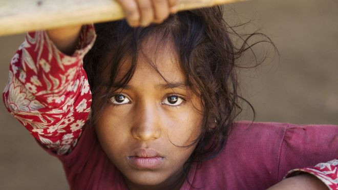 New arrival Shahida Begum waits in a pen to be processed at the refugee camp in Bangladesh