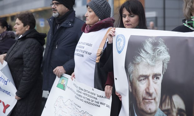 Protesters stand outside the court in The Hague with posters including one of Radovan Karadžić as they wait for the verdict on Ratko Mladic in November. (Photograph: Michel Porro/Getty Images)