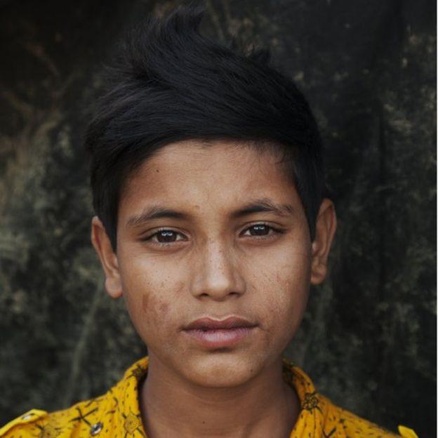 Image captionA young Rohingya refugee in the Bangladesh camp