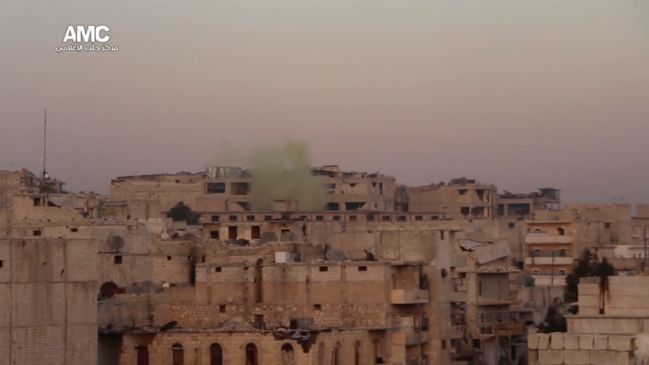 A still from video shows green smoke from a chlorine attack by Syrian government forces in the Daheert Awwad neighborhood of Aleppo, Syria on November 22, 2016. © 2016 Aleppo Media Center