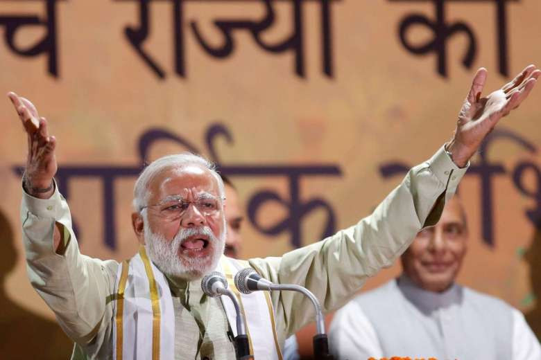 India's Prime Minister Narendra Modi addresses his supporters at Bharatiya Janata Party (BJP) headquarters in New Delhi on March 12, 2017. PHOTO: REUTERS