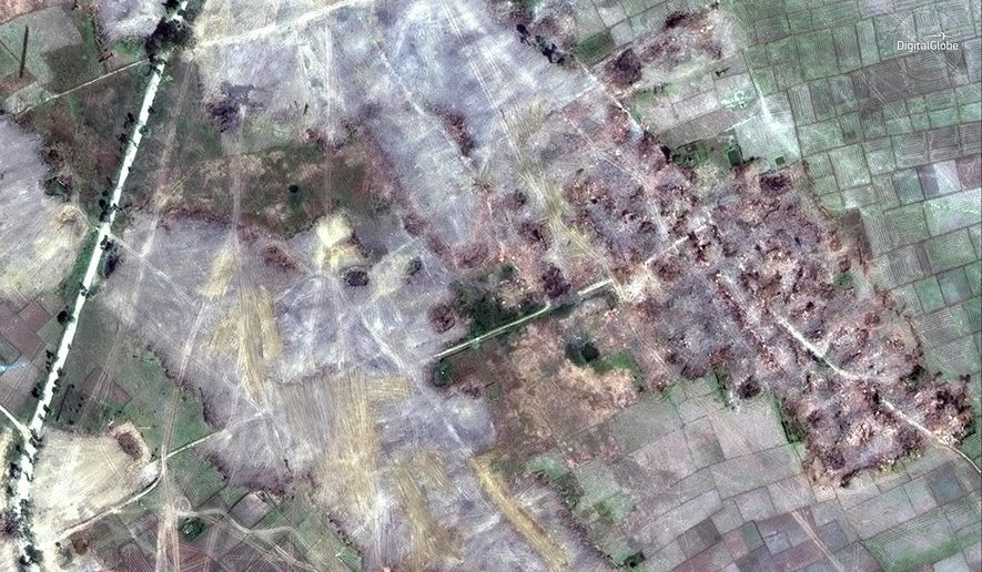 This Feb. 13, 2018, satellite image provided by DigitalGlobe, shows the village of Myin Hlut, 25 kilometers (15 miles) southeast of Maungdaw, Rakhine state, Myanmar. Satellite images of Myanmar's troubled Rakhine state, released to The Associated Press by Colorado-based DigitalGlobe on Friday, Feb. 23, 2018, show that dozens of empty villages and hamlets have been completely leveled by authorities in recent weeks, far more than previously reported. The villages were all set ablaze in the wake of violence last August, when a brutal clearance operation by security forces drove hundreds of thousands of Rohingya into exile in Bangladesh. (DigitalGlobe via AP)