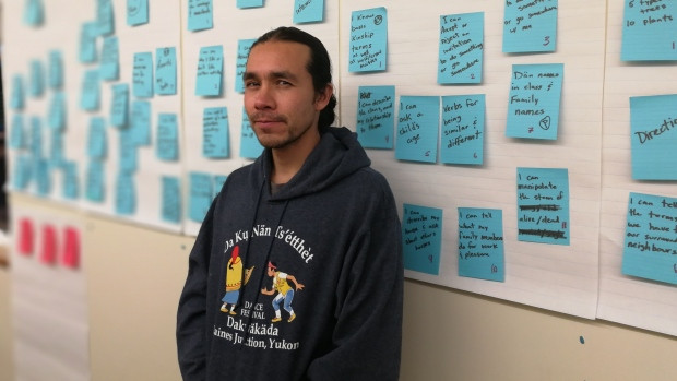 Stephen Reid, also known as Khasha, uses sticky notes on the wall outside his office to develop the curriculum to teach Southern Tutchone. (Meagan Deuling/CBC)