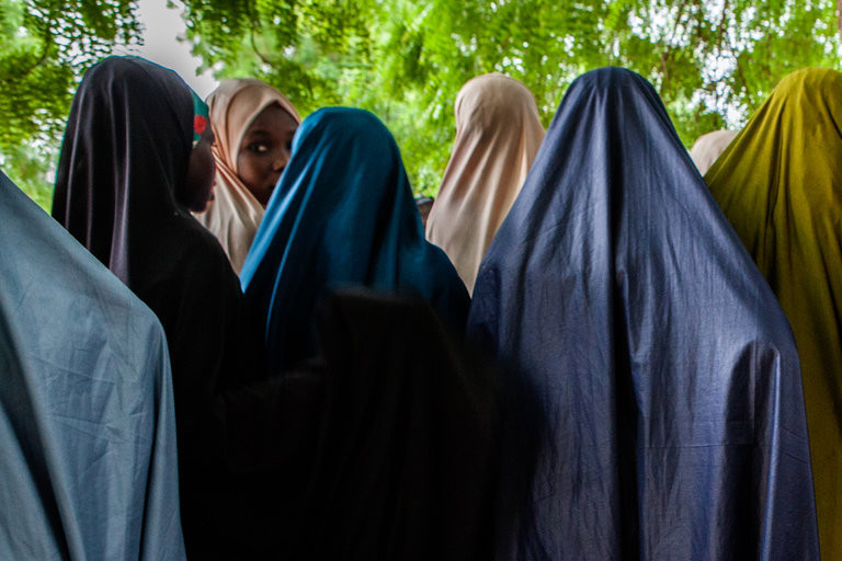 Former wives of Boko Haram commanders in June at a guarded compound in Maiduguri, Nigeria. Credit Jane Hahn for The New York Times