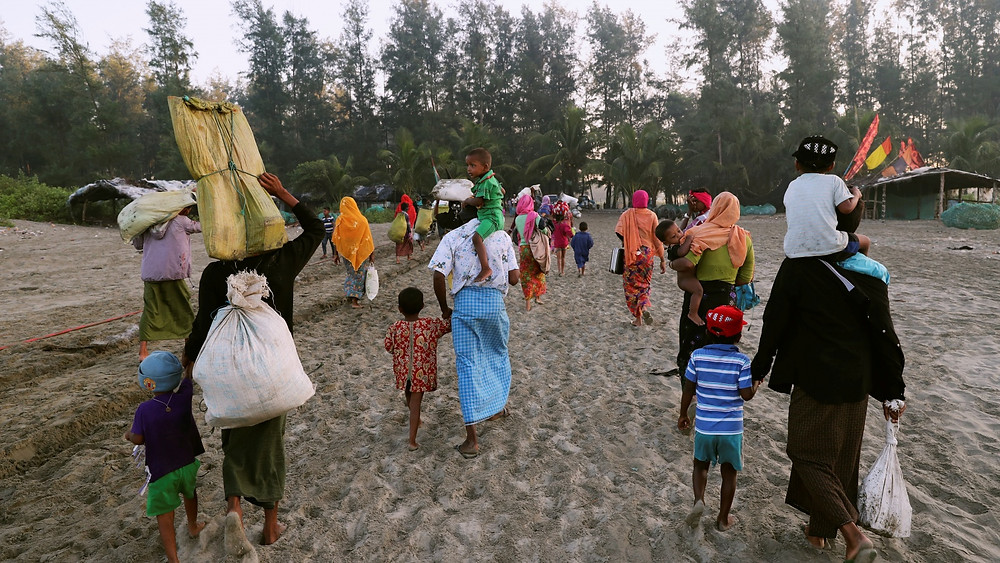 A group of Rohingya refugees, who fled last night from Myanmar by boat, walk towards a makeshift camp in Cox's Bazar, Bangladesh REUTERS/Mohammad Ponir Hossain