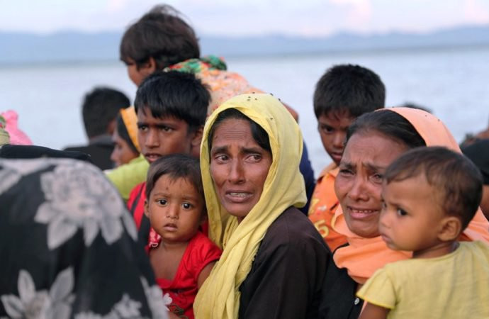 Rohingya refugee women cry while crossing the Naf River with an improvised raft to reach to Bangladesh in Teknaf, Bangladesh, November 12, 2017Reuters