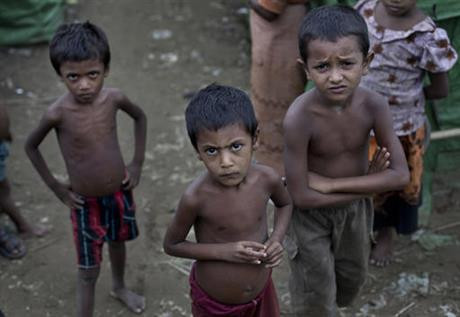 In this June 24 2014, file photo, Rohingya children gather at the Dar Paing camp for Muslim refugees, north of Sittwe, western Rakhine state, Myanmar. Activists this week have sent an open letter asking the major corporate investor conglomerate Unilever, which owns two factories near the capital Yangon, to speak out against the country's treatment of its Rohingya minority. (AP Photo/ Gemunu Amarasinghe, File)
