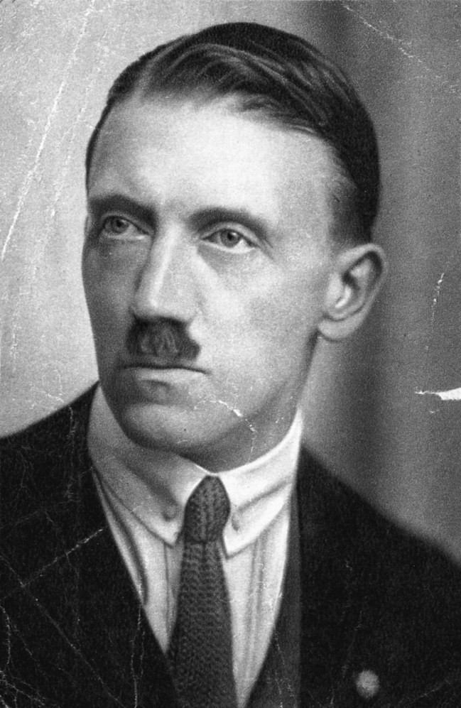 "Hitler, circa 1923. Five years later, he noted, approvingly, that white Americans had ""gunned down . . . millions of redskins.""  Photograph from Hulton-Deutsch Collection / Corbis / Getty"