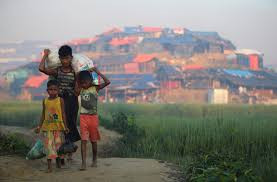 Rohingya refugee children carry supplies through Balukhali refugee camp near Cox's Bazar, Bangladesh, October 23, 2017. REUTERS/Hannah McKay