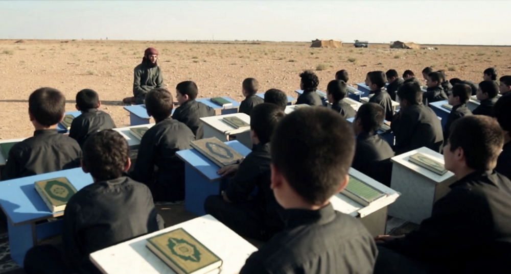 "An Islamic State propaganda video shows a teacher and young students. ""These small bodies are filled with the oneness of God,"" the teacher said, ""so when they explode they will kill and devastate."" (Obtained by The Washington Post)"