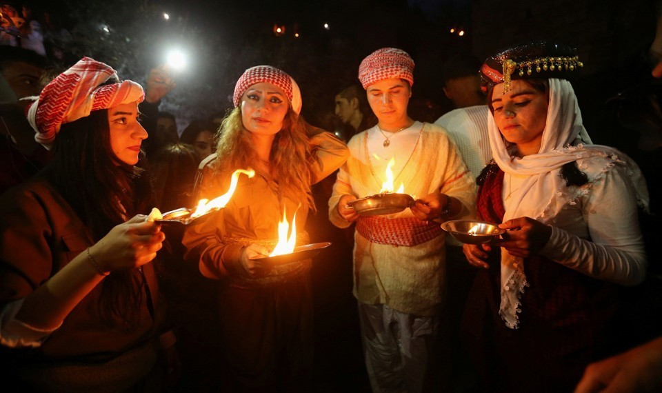 ezidis light candles and paraffin torches during a ceremony to celebrate the New Year in Dohuk province, Iraq, in 2017.