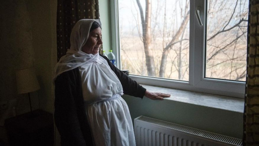 In this photo taken Wednesday, Dec. 21, 2016, a Yazidi refugee woman looks out of a window of a hotel room in the northern Greek village of Agios Athanasios, near Thessaloniki city. Portugal has offered to take in several hundred of the 2,500 Yazidi refugees living in Greece, arguing that the mistreated religious minority merits special protection. (AP Photo/Giannis Papanikos)  (The Associated Press)