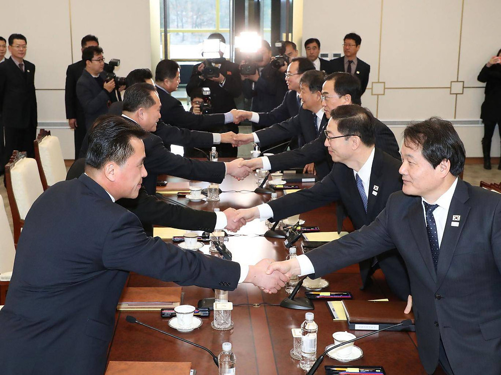 9 January 2018 Members of the South Korea delegation (R) shake hands with members of the North Korean delegation (L) during their meeting at the border truce village of Panmunjom in the Demilitarized Zone dividing the two Koreas. North and South Korea began their first official talks in more than two years, focusing on the forthcoming Winter Olympics after months of tensions over Pyongyang's nuclear weapons programme. AFP/Getty
