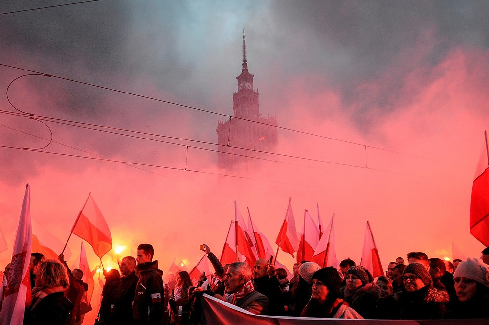 People parade through central Warsaw Nov. 11 ahead of the Polish capital's traditional Independence Day march. An estimated 60,000 people joined the march in what was described as one of the biggest gatherings of far-right activists in Europe in recent years. (Jaap Arriens/NurPhoto/Getty Images)