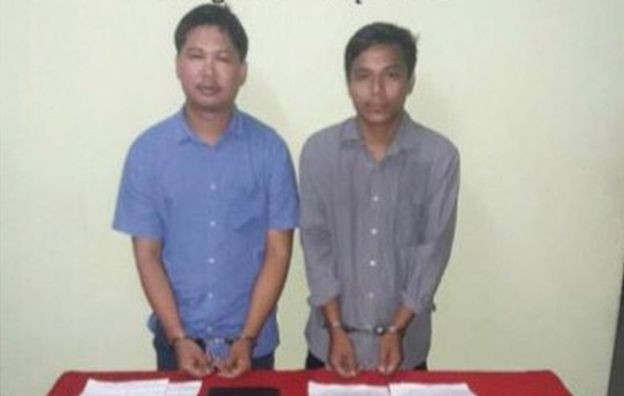 Image copyright MYANMAR GOVERNMENT The government released this picture of the two reporters in handcuffs